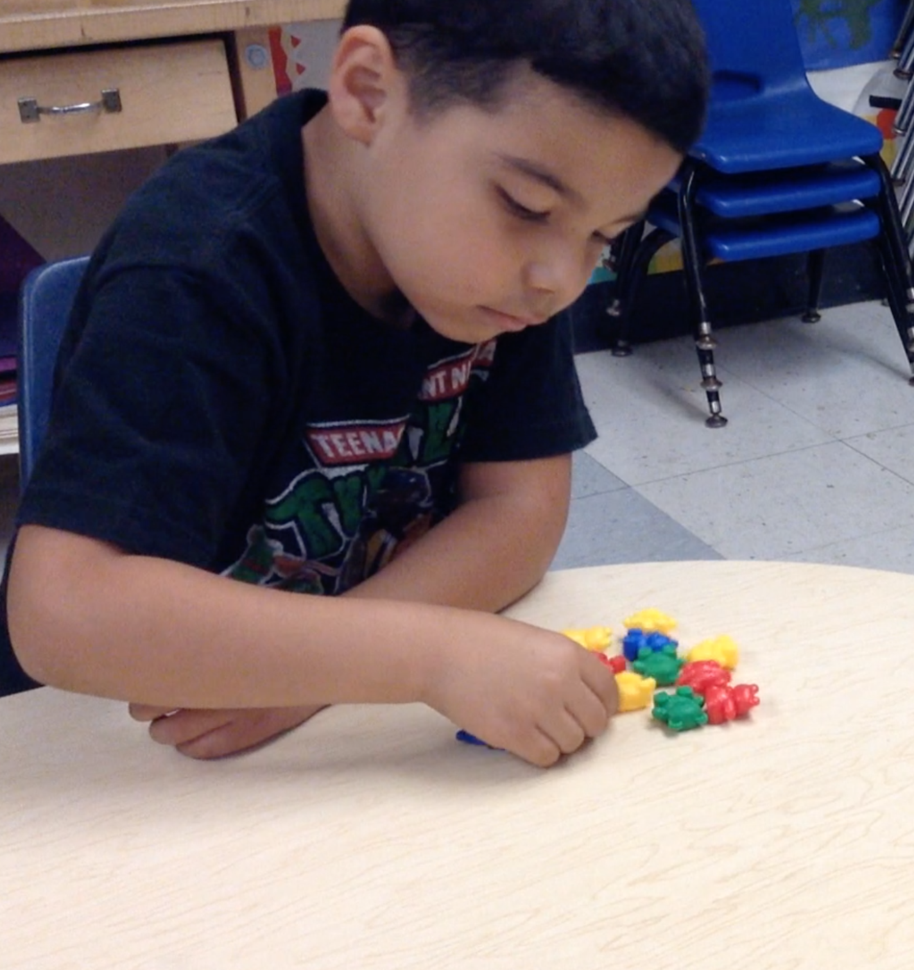 preschool student counting bears