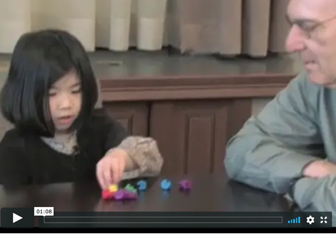 screenshot of video with young child and Herb Ginsburg