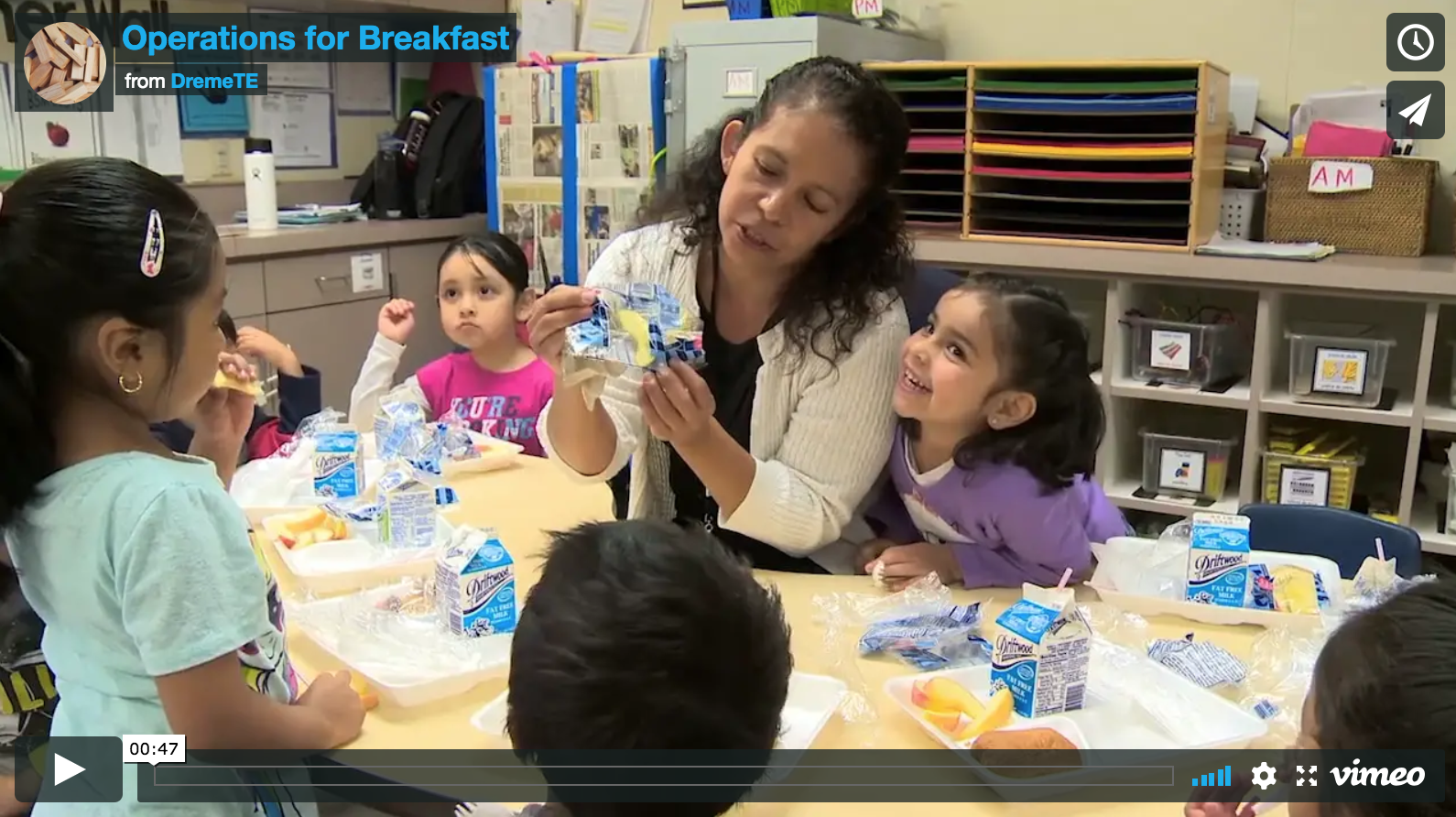 screenshot of video with Ms. Torres and her preschool students at breakfast table